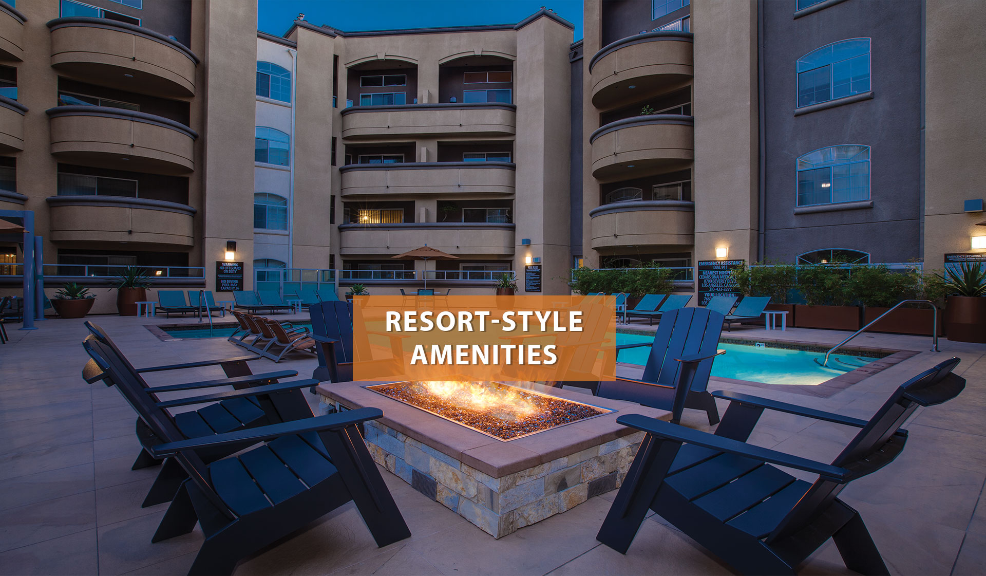 Broadcast Center Apartments - chairs around firepit by pool - Los Angeles, California